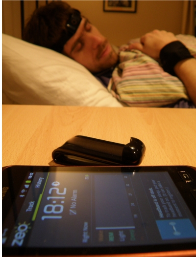 picture of me sleeping with zeo and fitbit sensors
